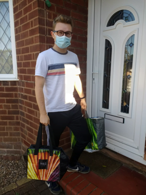 Boy with a face mask carrying a bag