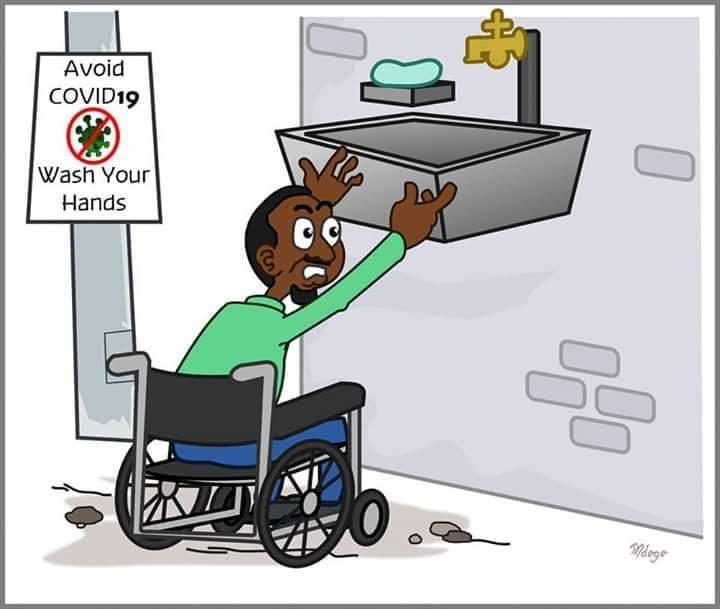"""The cartoon depicts a dark-skinned man in a wheelchair who lifts up his arms to wash his hands in the basin, which is still too high for him. The sign on the wall near the basin says """"Avoid COVID19. Wash your hands"""""""